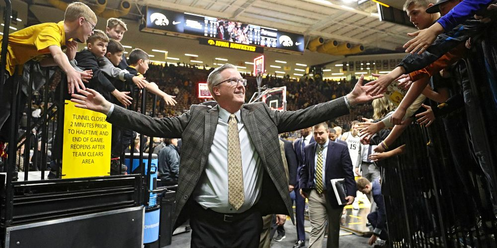 Iowa Hawkeyes head coach Fran McCaffery greets fans after winning their their game at Carver-Hawkeye Arena in Iowa City on Sunday, December 29, 2019. (Stephen Mally/hawkeyesports.com)