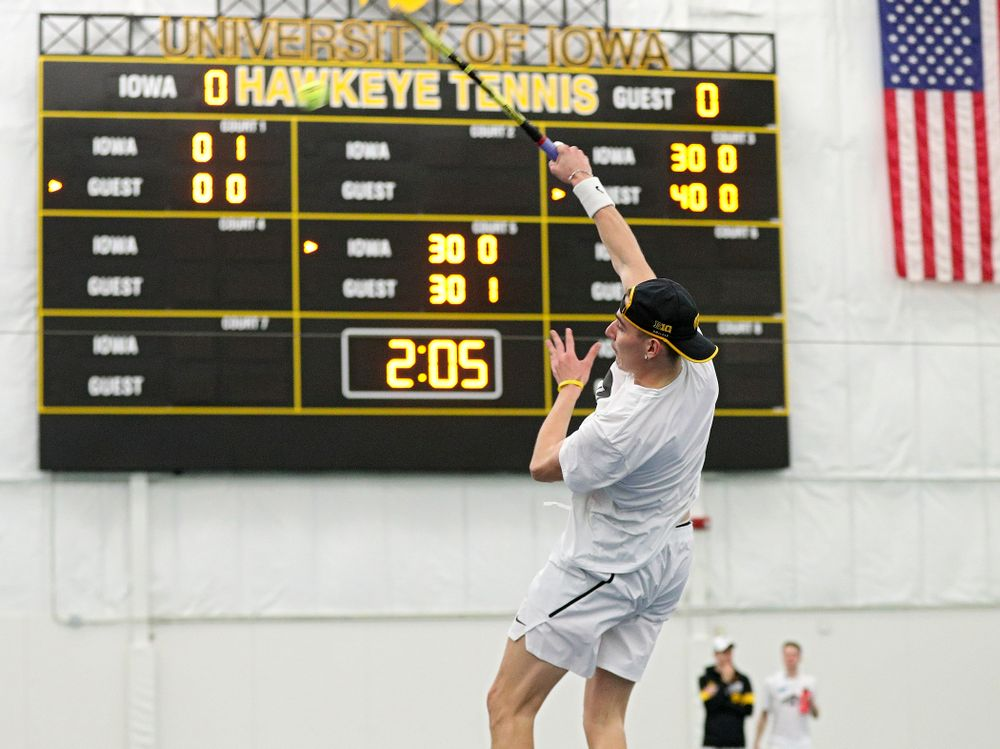 Iowa's Nikita Snezhko returns a shot during his doubles match at the Hawkeye Tennis and Recreation Complex in Iowa City on Sunday, February 16, 2020. (Stephen Mally/hawkeyesports.com)