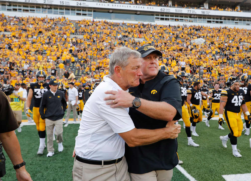 Iowa Hawkeyes head coach Kirk Ferentz shakes hands with head strength coach Chris Doyle following their game against the Northern Illinois Huskies Saturday, September 1, 2018 at Kinnick Stadium. (Brian Ray/hawkeyesports.com)