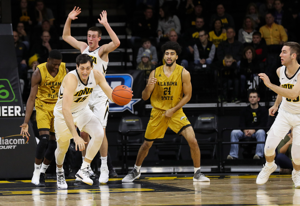 Iowa Hawkeyes forward Ryan Kriener (15) dribbles the ball during a game against Alabama State at Carver-Hawkeye Arena on November 21, 2018. (Tork Mason/hawkeyesports.com)
