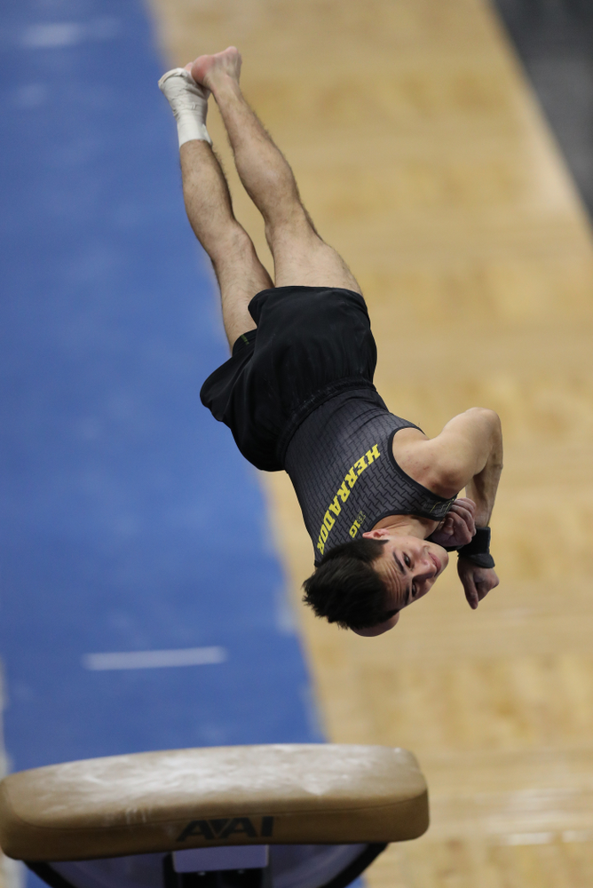 Iowa's Andrew Herrador competes on the vault against Oklahoma Saturday, February 9, 2019 at Carver-Hawkeye Arena. (Brian Ray/hawkeyesports.com)