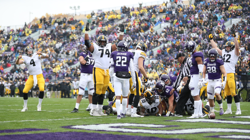 Iowa Hawkeyes offensive lineman Tristan Wirfs (74) celebrates a touchdown by running back Mekhi Sargent (10) against the Northwestern Wildcats Saturday, September 28, 2019 at Kinnick Stadium. (Max Allen/hawkeyesports.com)
