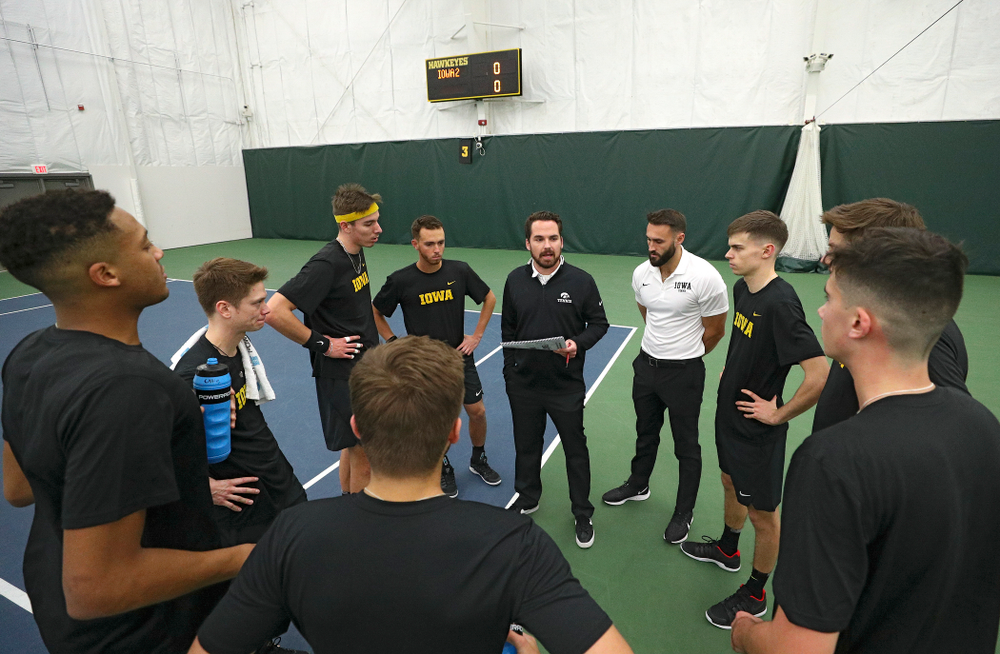 Iowa head coach Ross Wilson talks with his team before their match at the Hawkeye Tennis and Recreation Complex in Iowa City on Thursday, January 16, 2020. (Stephen Mally/hawkeyesports.com)