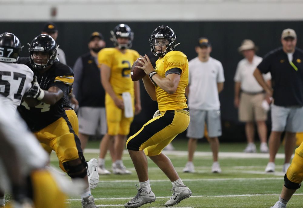 Iowa Hawkeyes quarterback Nate Stanley (4) during Fall Camp Practice No. 6 Thursday, August 8, 2019 at the Ronald D. and Margaret L. Kenyon Football Practice Facility. (Brian Ray/hawkeyesports.com)