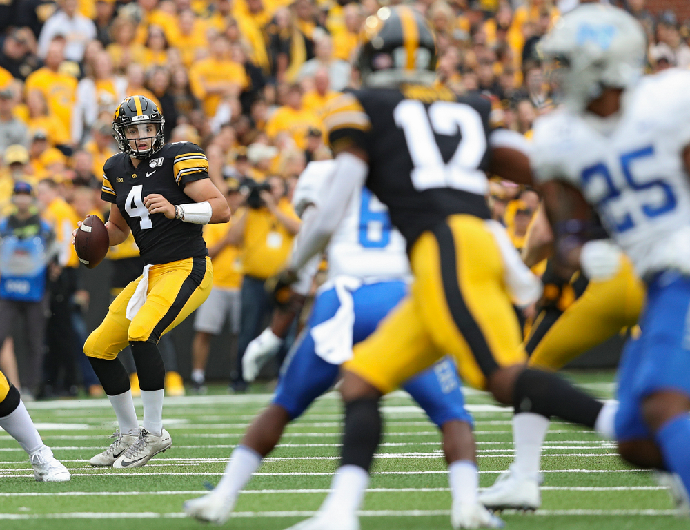 Iowa Hawkeyes quarterback Nate Stanley (4) looks to pass during the first quarter of their game at Kinnick Stadium in Iowa City on Saturday, Sep 28, 2019. (Stephen Mally/hawkeyesports.com)