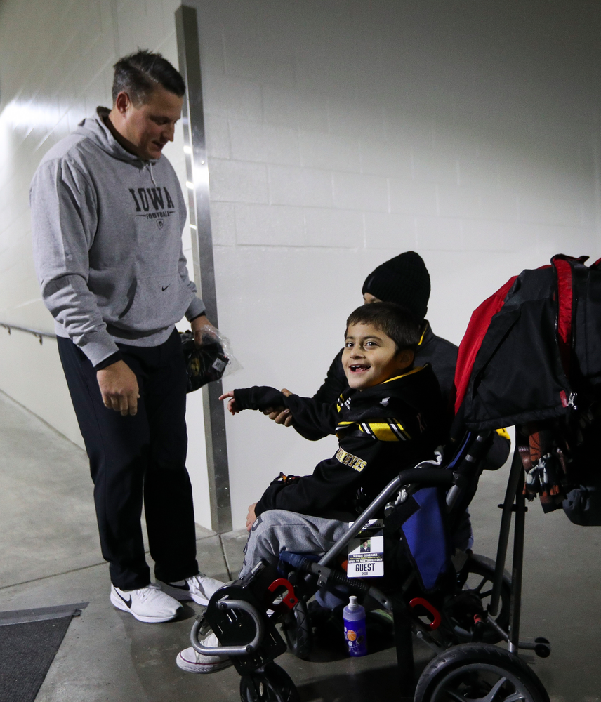 Iowa Hawkeyes offensive coordinator Brian Ferentz meets with Kid Captain Mason Gonzalez before a game against Northwestern at Kinnick Stadium on November 10, 2018. (Tork Mason/hawkeyesports.com)