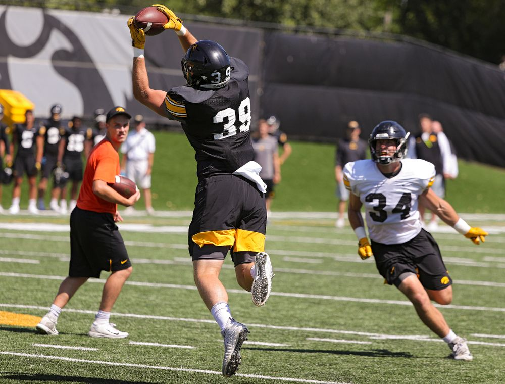 Iowa Hawkeyes tight end Nate Wieting (39) pulls in a pass as linebacker Kristian Welch (34) looks on during Fall Camp Practice No. 7 at the Hansen Football Performance Center in Iowa City on Friday, Aug 9, 2019. (Stephen Mally/hawkeyesports.com)