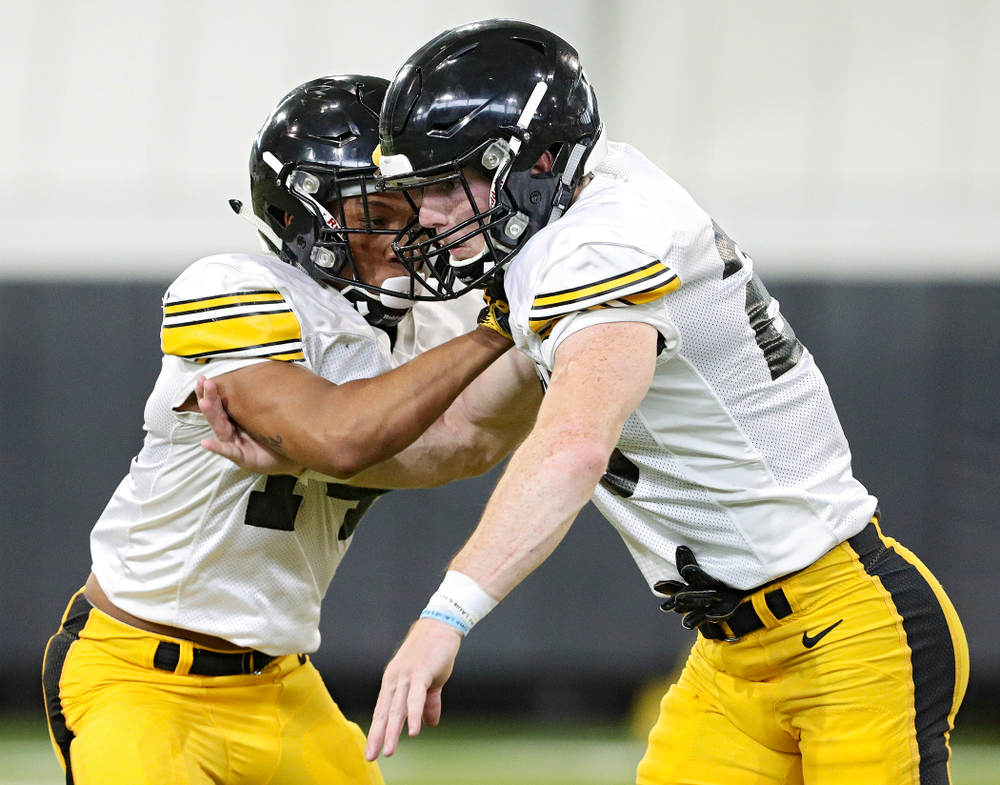 Iowa Hawkeyes defensive back Daraun McKinney (from left) and defensive back Jack Koerner work on a drill during Fall Camp Practice No. 6 at the Hansen Football Performance Center in Iowa City on Thursday, Aug 8, 2019. (Stephen Mally/hawkeyesports.com)