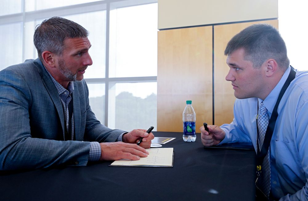 Aaron Kampman (from left), former Iowa defensive end, talks with offensive lineman Cole Banwart as former players meet with members of the current Hawkeye Football team during a networking event at Kinnick Stadium in Iowa City on Thursday, Jun 6, 2019. (Stephen Mally/hawkeyesports.com)