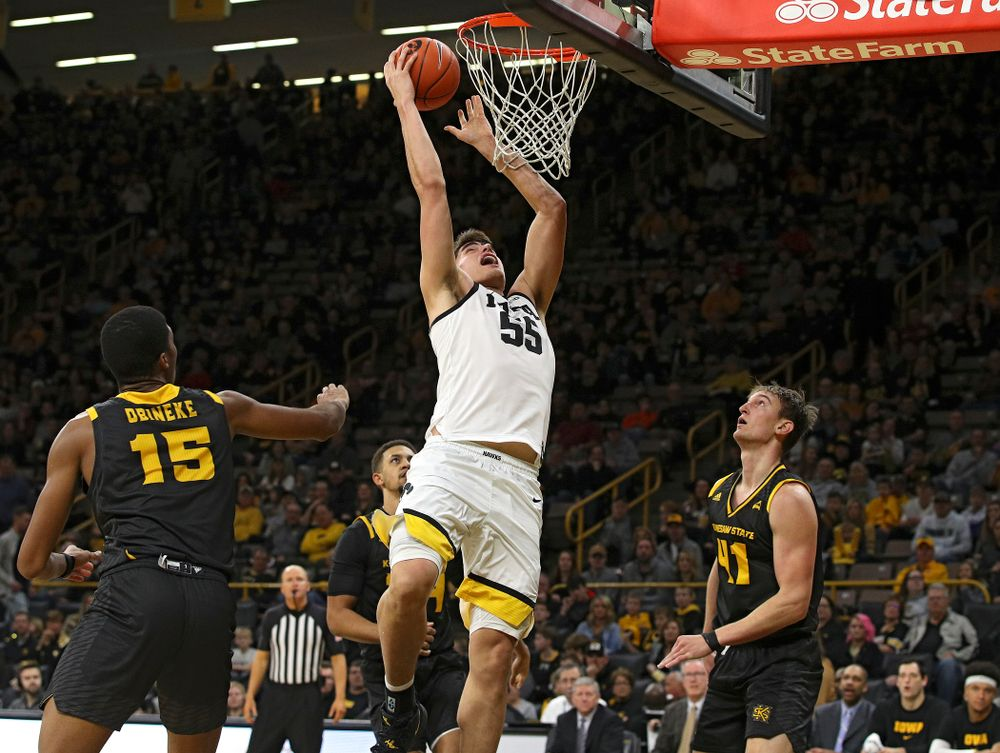 Iowa Hawkeyes center Luka Garza (55) makes a basket during the second half of their their game at Carver-Hawkeye Arena in Iowa City on Sunday, December 29, 2019. (Stephen Mally/hawkeyesports.com)