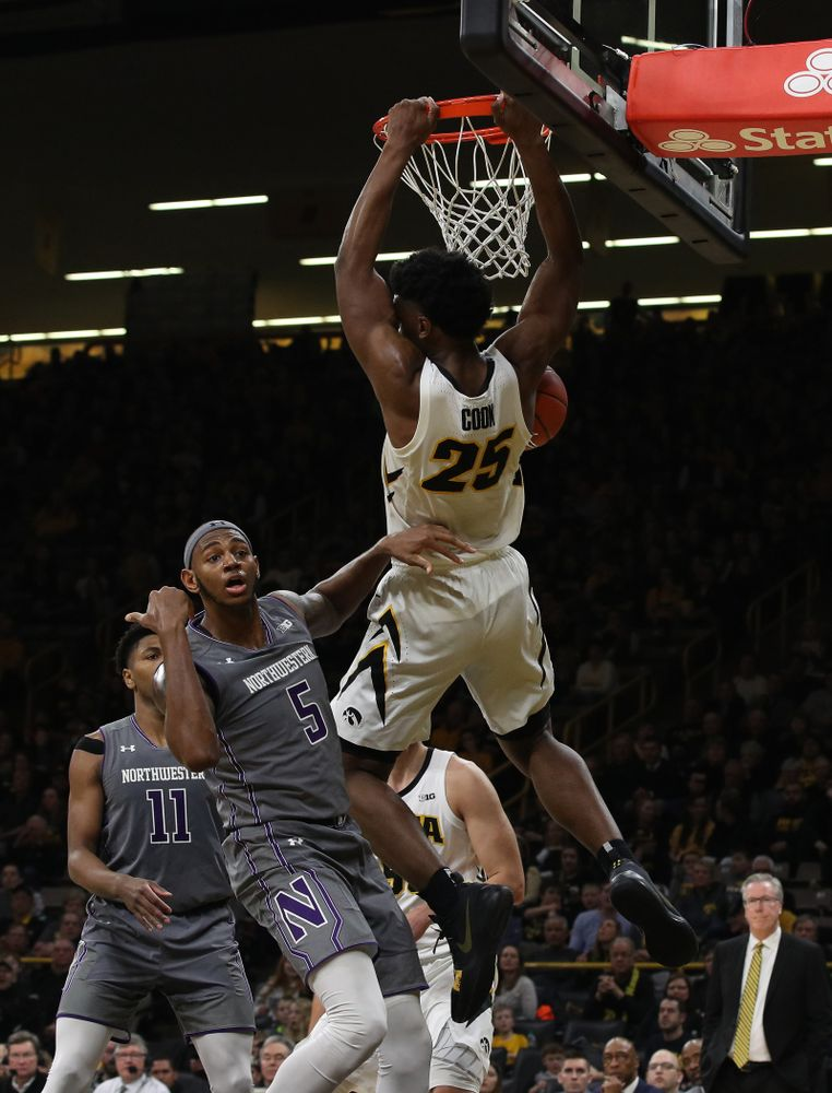 Iowa Hawkeyes forward Tyler Cook (25) gets the dunk and foul against the Northwestern Wildcats Sunday, February 10, 2019 at Carver-Hawkeye Arena. (Brian Ray/hawkeyesports.com)