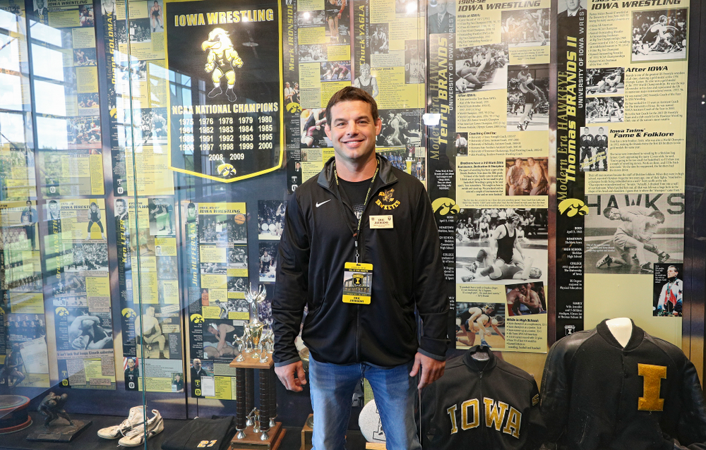 2019 University of Iowa Athletics Hall of Fame inductee Eric Juergens by the wrestling display at the University of Iowa Athletics Hall of Fame in Iowa City on Friday, Aug 30, 2019. (Stephen Mally/hawkeyesports.com)