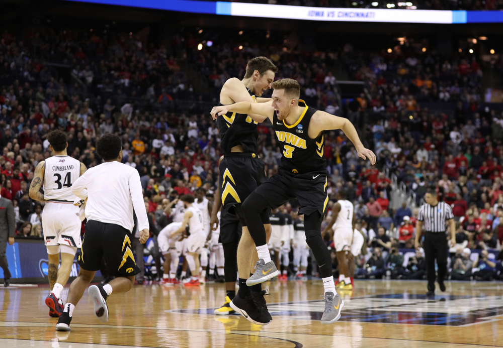 Iowa Hawkeyes guard Jordan Bohannon (3) and forward Nicholas Baer (51) against the Cincinnati Bearcats in the first round of the 2019 NCAA Men's Basketball Tournament Friday, March 22, 2019 at Nationwide Arena in Columbus, Ohio. (Brian Ray/hawkeyesports.com)
