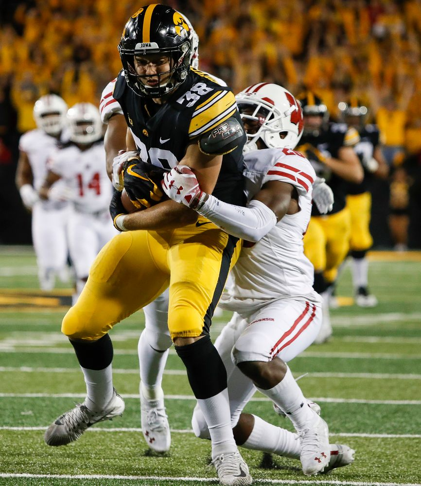 Iowa Hawkeyes tight end T.J. Hockenson (38) is tackled after making a first down reception during a game against Wisconsin at Kinnick Stadium on September 22, 2018. (Tork Mason/hawkeyesports.com)