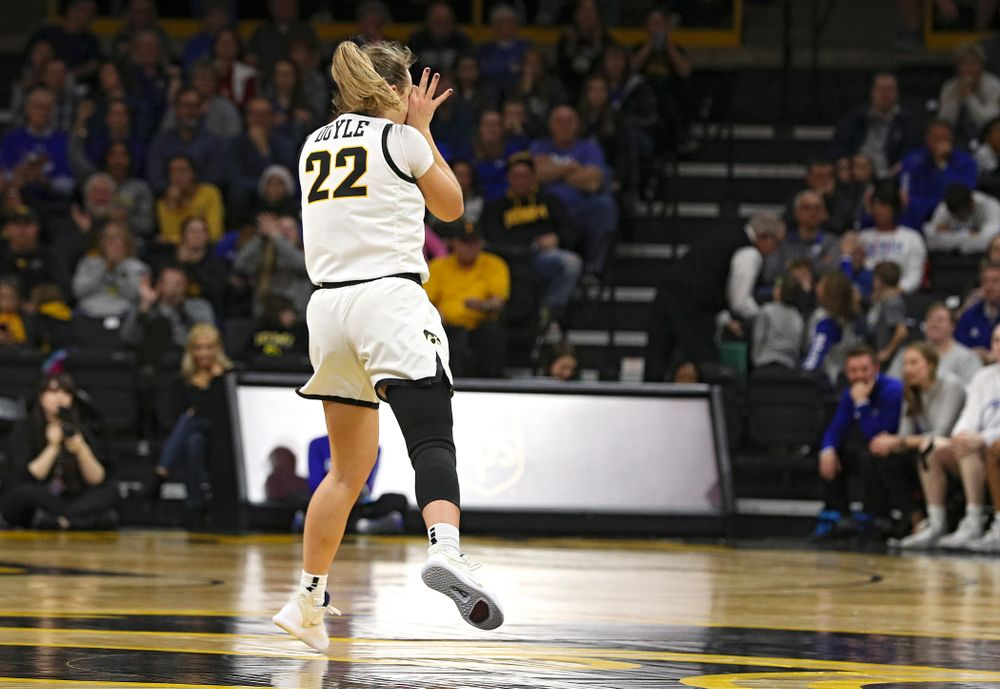 Iowa Hawkeyes guard Kathleen Doyle (22) holds up three-point goggles after making a 3-pointer during the fourth quarter of their game at Carver-Hawkeye Arena in Iowa City on Saturday, December 21, 2019. (Stephen Mally/hawkeyesports.com)