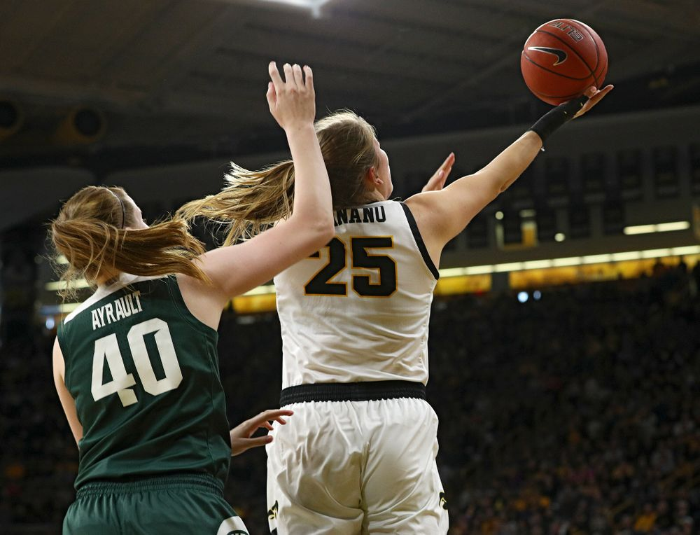 Iowa Hawkeyes forward Monika Czinano (25) scores a basket during the first quarter of their game at Carver-Hawkeye Arena in Iowa City on Sunday, January 26, 2020. (Stephen Mally/hawkeyesports.com)