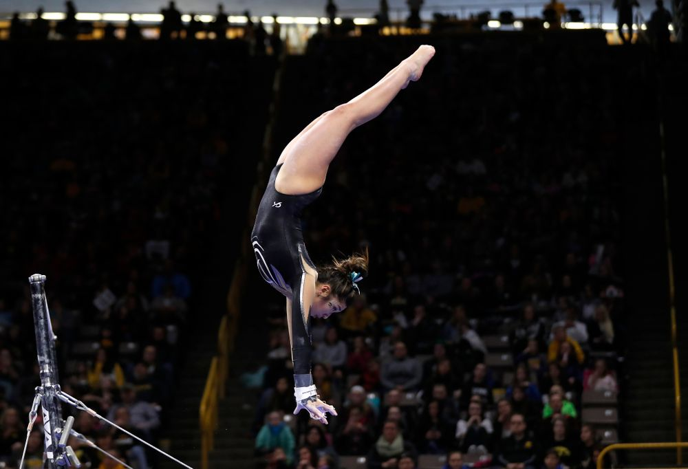 Iowa's Nicole Chow competes on the bars against the Nebraska Cornhuskers