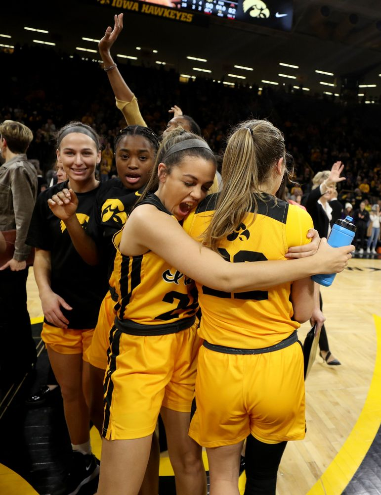 Iowa Hawkeyes guard Gabbie Marshall (24) and guard Kathleen Doyle (22) against the Minnesota Golden Gophers Thursday, February 27, 2020 at Carver-Hawkeye Arena. (Brian Ray/hawkeyesports.com)