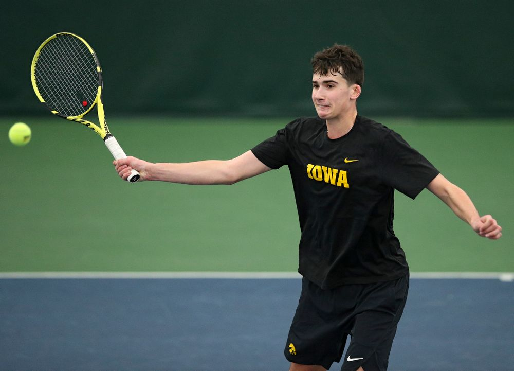 Iowa's Matt Clegg returns a shot during his doubles match at the Hawkeye Tennis and Recreation Complex in Iowa City on Friday, March 6, 2020. (Stephen Mally/hawkeyesports.com)