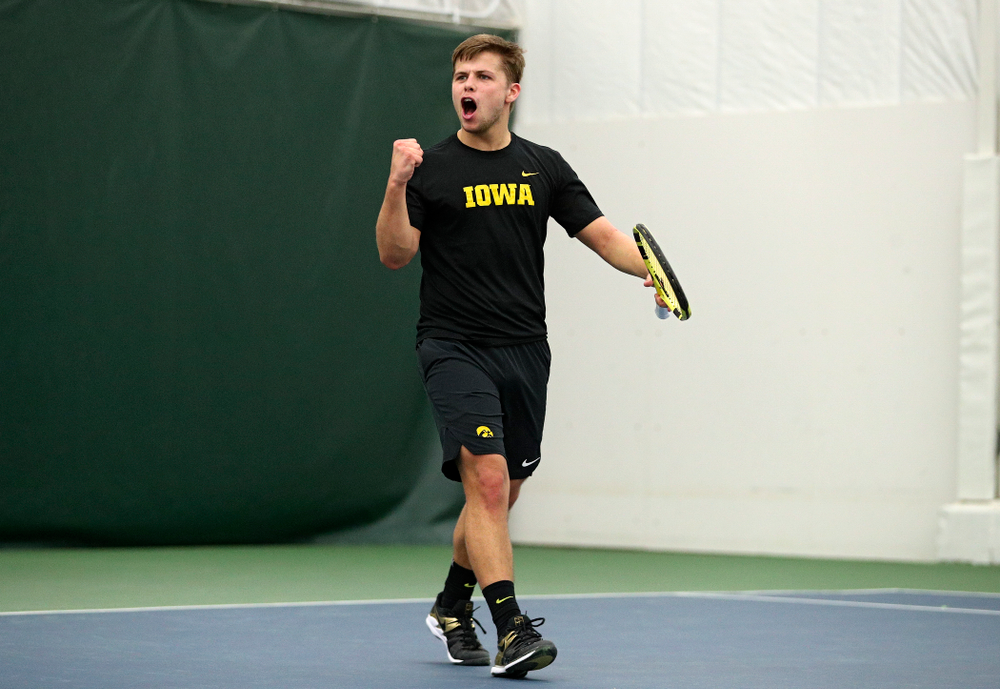 Iowa's Will Davies celebrates after winning his singles match at the Hawkeye Tennis and Recreation Complex in Iowa City on Friday, March 6, 2020. (Stephen Mally/hawkeyesports.com)