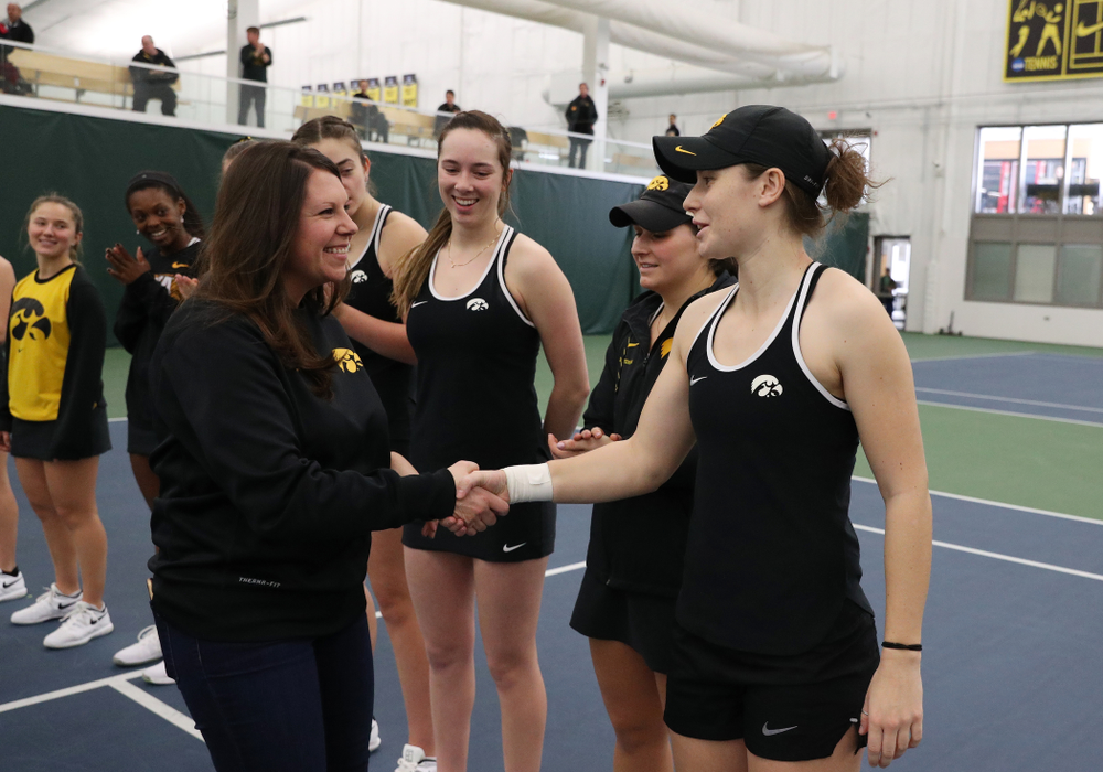 Academic Student Services Associate Director Kara Park congratulates Elise Van Heuvelen for earning a 3.0 GPA or better during the fall semester before their match against the Penn State Nittany Lions Sunday, February 24, 2019 at the Hawkeye Tennis and Recreation Complex. (Brian Ray/hawkeyesports.com)