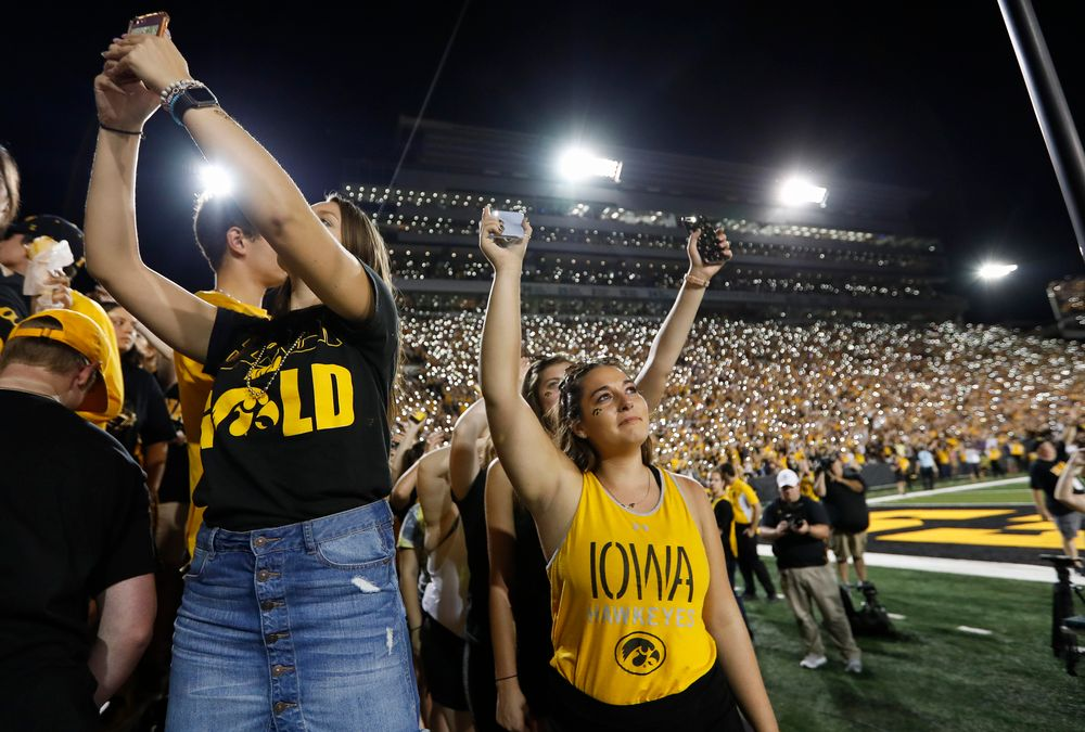 Fans wave to patients in the Stead Family Children's Hospital at halftime during a game against Northern Iowa at Kinnick Stadium on September 15, 2018. (Tork Mason/hawkeyesports.com)