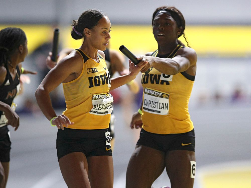 Iowa's Anaya Alexander (from left) takes the baton from Antonise Christian as they run the women's 1600 meter relay event during the Hawkeye Invitational at the Recreation Building in Iowa City on Saturday, January 11, 2020. (Stephen Mally/hawkeyesports.com)