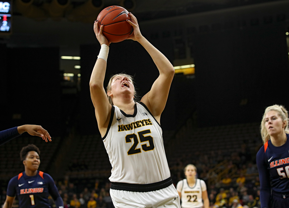Iowa Hawkeyes forward Monika Czinano (25) scores a basket inside during the first quarter of their game at Carver-Hawkeye Arena in Iowa City on Tuesday, December 31, 2019. (Stephen Mally/hawkeyesports.com)