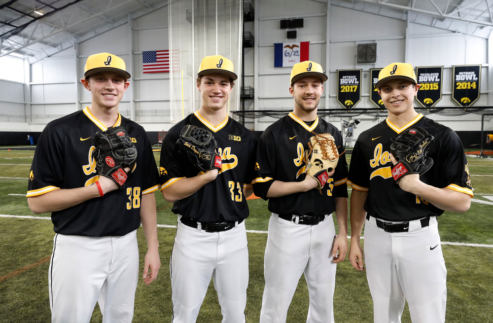 Iowa Hawkeyes pitcher Trenton Wallace (38), pitcher Jack Dreyer (33), pitcher Cam Baumann (35), and pitcher Ben Probst (19) Thursday, February 8, 2018 during the team's annual media day Thursday, February 8, 2018 in the indoor practice facility. (Brian Ray/hawkeyesports.com)