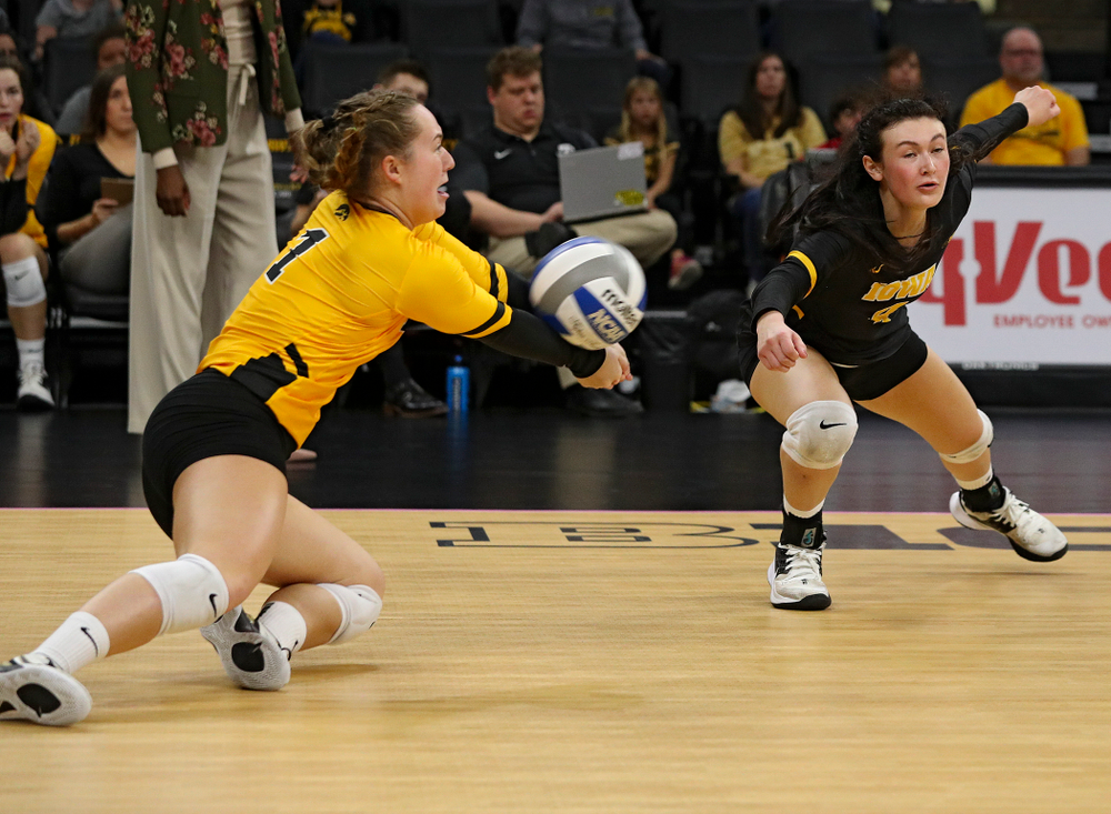 Iowa's Joslyn Boyer (1) dives for a dig as Halle Johnston (4) tries to reach the ball during their match at Carver-Hawkeye Arena in Iowa City on Sunday, Oct 20, 2019. (Stephen Mally/hawkeyesports.com)