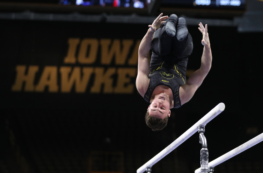 Iowa's Jake Brodarzon competes on the parallel bars against the Ohio State Buckeyes  Saturday, March 16, 2019 at Carver-Hawkeye Arena.  (Brian Ray/hawkeyesports.com)