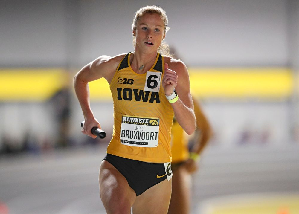 Iowa's Mariel Bruxvoort runs the women's 1600 meter relay event during the Hawkeye Invitational at the Recreation Building in Iowa City on Saturday, January 11, 2020. (Stephen Mally/hawkeyesports.com)