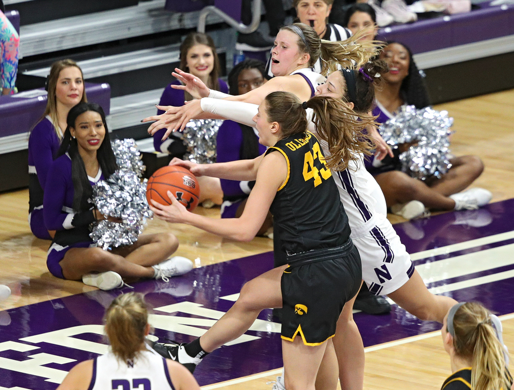 Iowa Hawkeyes forward Amanda Ollinger (43) pulls in a rebound during the fourth quarter of their game at Welsh-Ryan Arena in Evanston, Ill. on Sunday, January 5, 2020. (Stephen Mally/hawkeyesports.com)