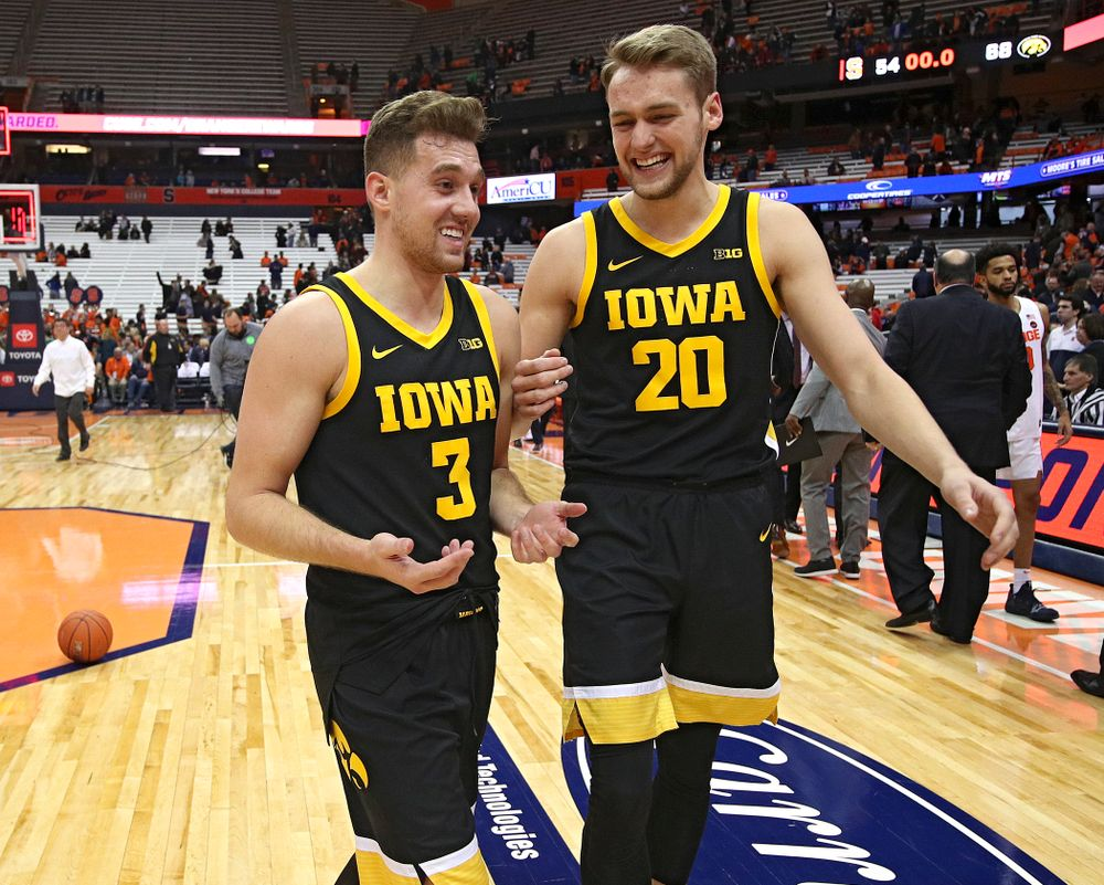 Iowa Hawkeyes guard Jordan Bohannon (3) and forward Riley Till (20) talk after winning their ACC/Big Ten Challenge game at the Carrier Dome in Syracuse, N.Y. on Tuesday, Dec 3, 2019. (Stephen Mally/hawkeyesports.com)