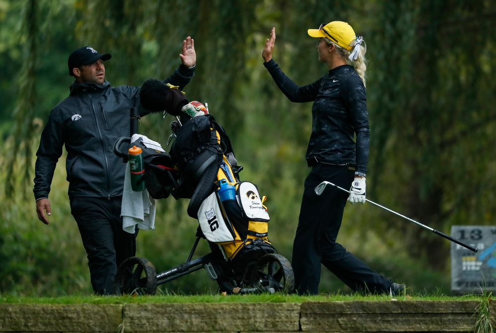 Iowa's Shawn Rennegarbe high-fives assistant coach Michael Roters after hitting a tee shot during the final round of the Diane Thomason Invitational at Finkbine Golf Course on September 30, 2018. (Tork Mason/hawkeyesports.com)