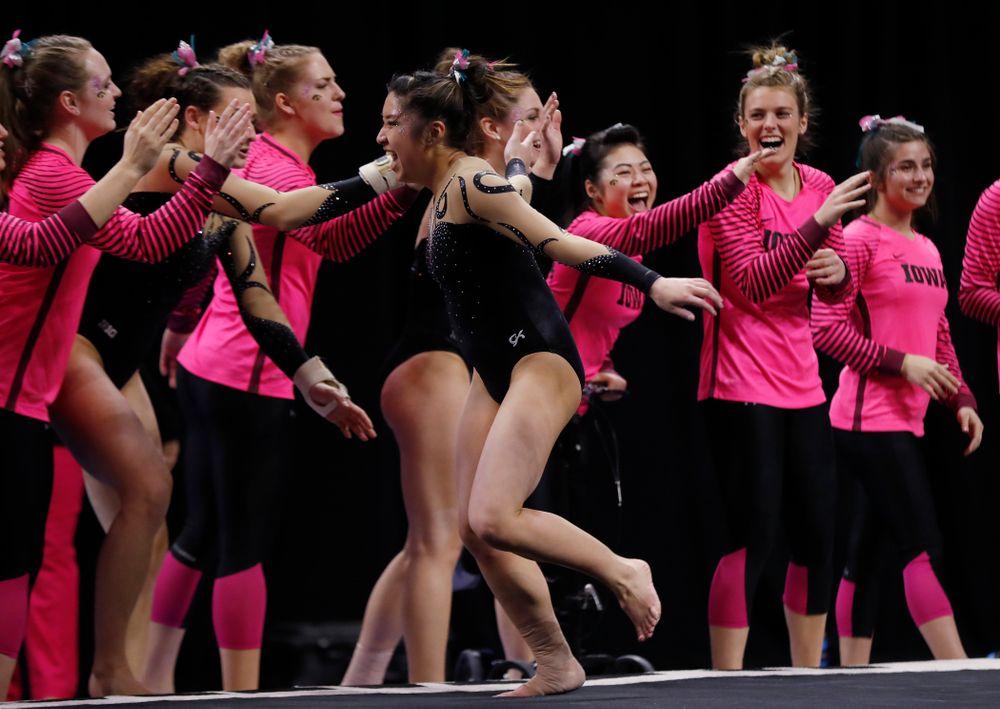 Iowa's Nicole Chow competes on the floor
