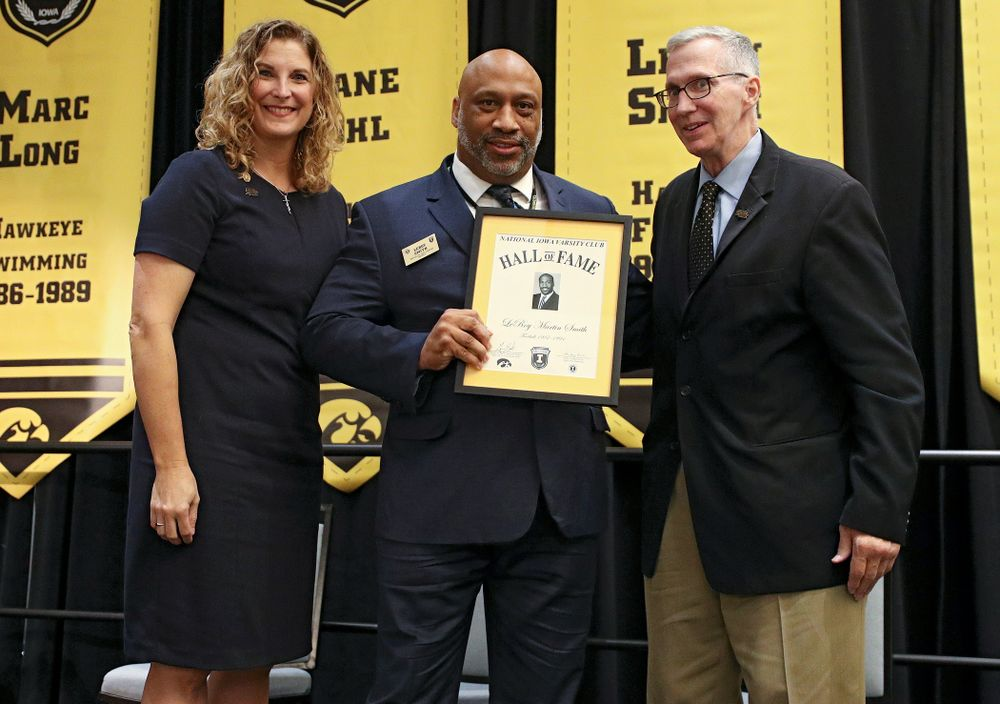 Barb Randall (from left), co-chair of the Varsity Club Advisory Committee, 2019 University of Iowa Athletics Hall of Fame inductee LeRoy Smith, and Andy Piro, assistant athletics director and executive director of the Varsity Club, during the Hall of Fame Induction Ceremony at the Coralville Marriott Hotel and Conference Center in Coralville on Friday, Aug 30, 2019. (Stephen Mally/hawkeyesports.com)