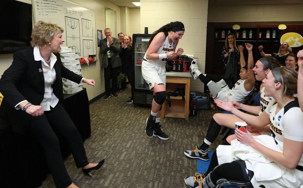 Iowa Hawkeyes head coach Lisa Bluder and forward Megan Gustafson (10) against the NC State Wolfpack in the regional semi-final of the 2019 NCAA Women's College Basketball Tournament Saturday, March 30, 2019 at Greensboro Coliseum in Greensboro, NC.(Brian Ray/hawkeyesports.com)