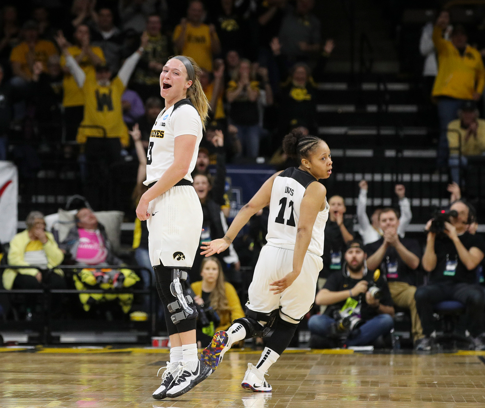 Iowa Hawkeyes guard Makenzie Meyer (3) is pumped up after making a 3-pointer as guard Tania Davis (11) looks on during the second quarter of their second round game in the 2019 NCAA Women's Basketball Tournament at Carver Hawkeye Arena in Iowa City on Sunday, Mar. 24, 2019. (Stephen Mally for hawkeyesports.com)