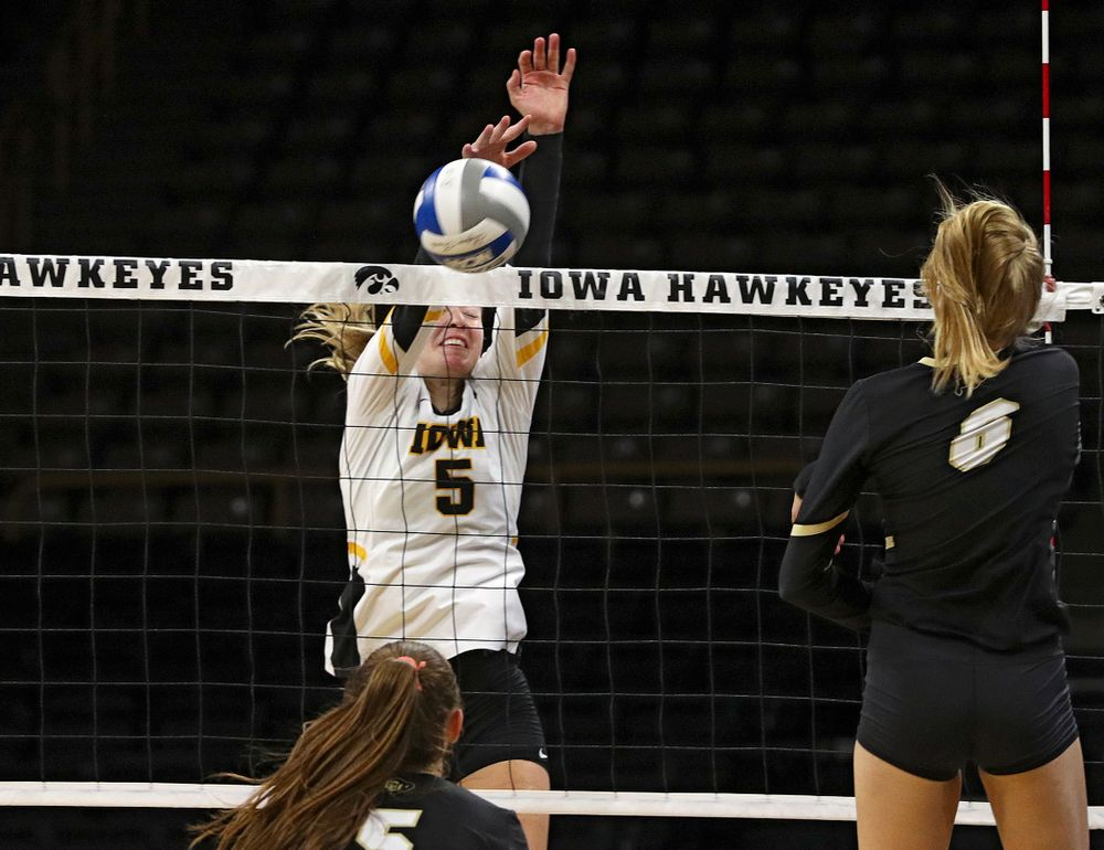 Iowa's Meghan Buzzerio (5) blocks a shot during the third set of their Big Ten/Pac-12 Challenge match against Colorado at Carver-Hawkeye Arena in Iowa City on Friday, Sep 6, 2019. (Stephen Mally/hawkeyesports.com)