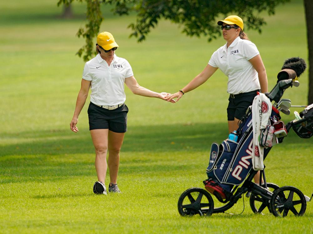 Iowa head coach Megan Menzel gives Sarah Overton a high-five during their dual against Northern Iowa at Pheasant Ridge Golf Course in Cedar Falls on Monday, Sep 2, 2019. (Stephen Mally/hawkeyesports.com)