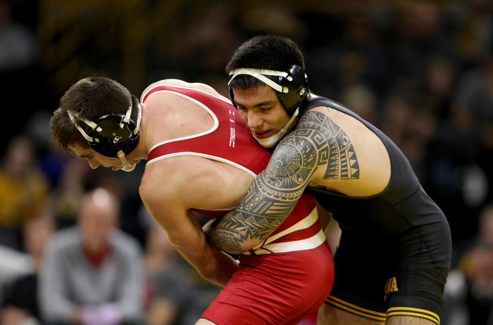 IowaÕs Pat Lugo wrestles WisconsinÕs Cole Martin at 149 pounds Sunday, December 1, 2019 at Carver-Hawkeye Arena. Lugo won the match 5-3. (Brian Ray/hawkeyesports.com)