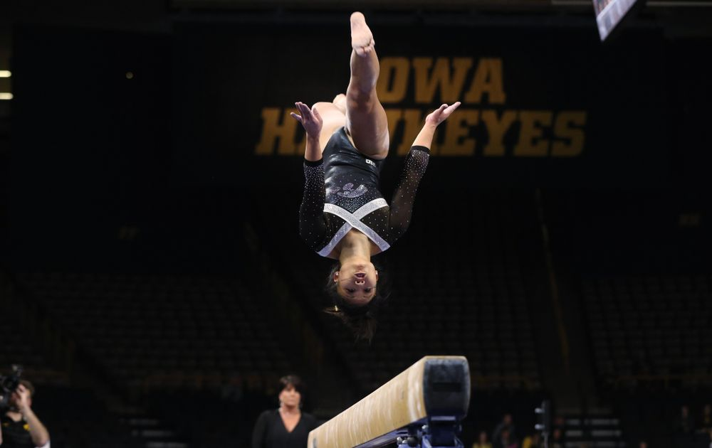Iowa's Misty-Jade Carlson competes on the beam against the Rutgers Scarlet Knights Saturday, January 26, 2019 at Carver-Hawkeye Arena. (Brian Ray/hawkeyesports.com)