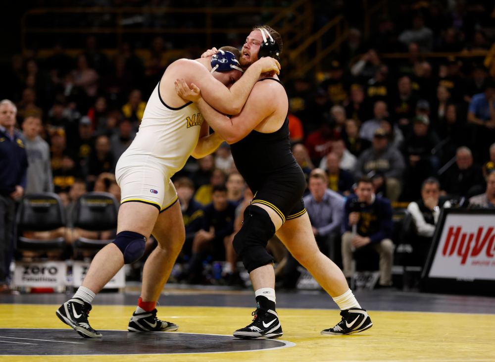 Iowa's Sam Stoll against Michigan's Adam Coon at heavyweight