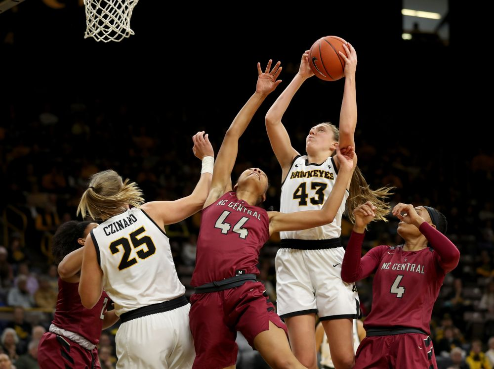 Iowa Hawkeyes forward Amanda Ollinger (43) grabs a rebound against North Carolina Central Saturday, December 14, 2019 at Carver-Hawkeye Arena. (Brian Ray/hawkeyesports.com)