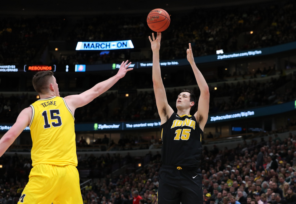 Iowa Hawkeyes forward Ryan Kriener (15) against the Michigan Wolverines in the 2019 Big Ten Men's Basketball Tournament Friday, March 15, 2019 at the United Center in Chicago. (Brian Ray/hawkeyesports.com)