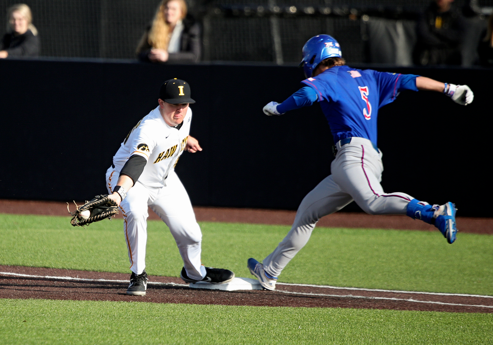 Iowa first baseman Peyton Williams (45) pulls in a throw for an out during the ninth inning of their college baseball game at Duane Banks Field in Iowa City on Wednesday, March 11, 2020. (Stephen Mally/hawkeyesports.com)
