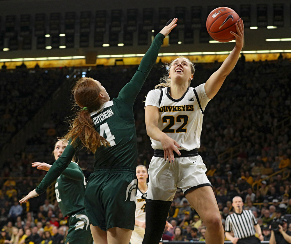 Iowa Hawkeyes guard Kathleen Doyle (22) scores a basket during the first quarter of their game at Carver-Hawkeye Arena in Iowa City on Sunday, January 26, 2020. (Stephen Mally/hawkeyesports.com)