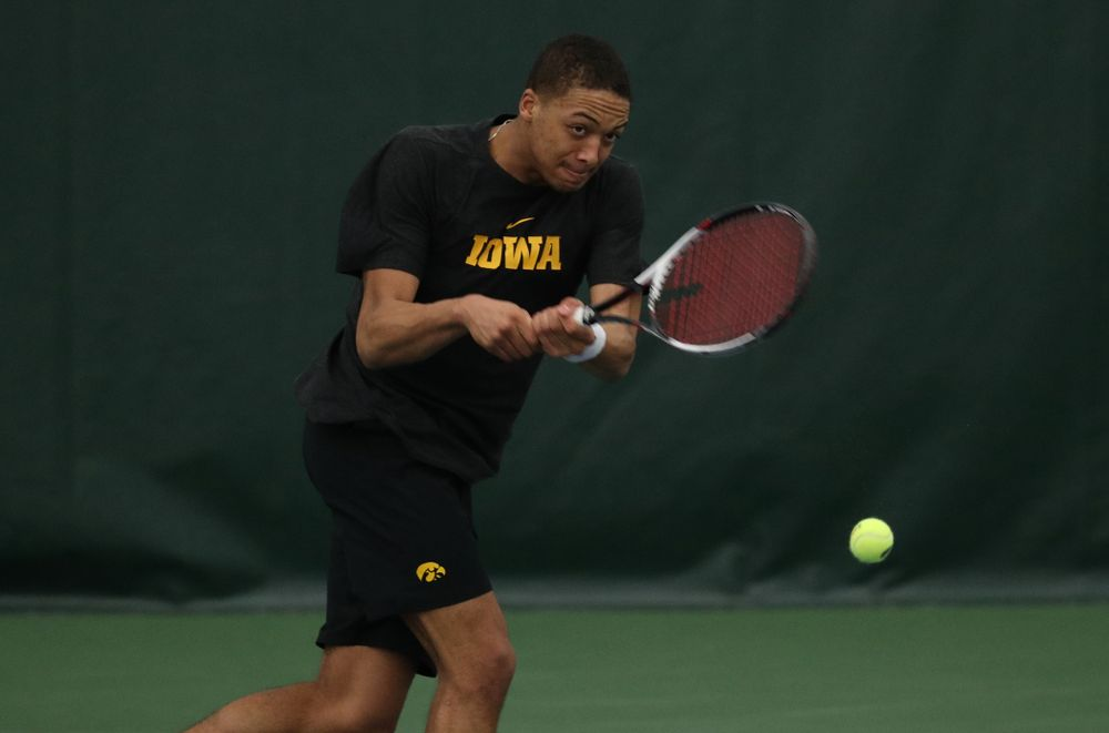 Iowa's Oliver Okonkwo against UMKC Friday, February 15, 2019 at the Hawkeye Tennis and Recreation Complex. (Brian Ray/hawkeyesports.com)