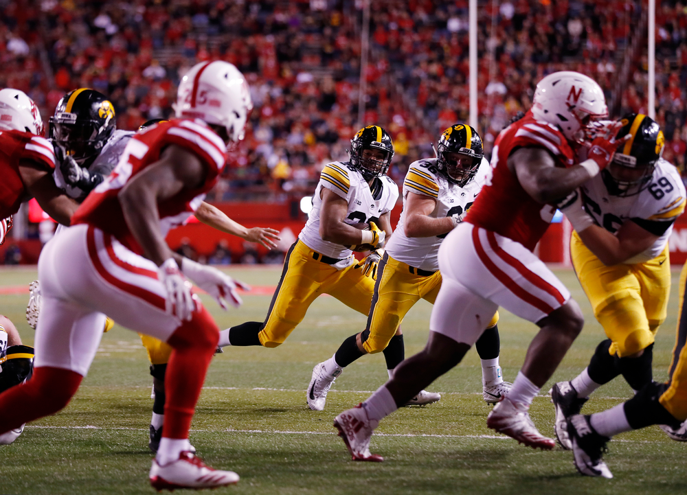 Iowa Hawkeyes running back Toren Young (28) and fullback Brady Ross (36)